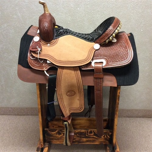 """16"""" #1907 Billy Cook Barrel Saddle - Signature quilted stitching and tooled cheyenne roll cantle make this seat a work of art! Designed on a BW barrel tree - rawhide covered for strength and durability - you'll be turning barrels for years to come. A close contact cutout skirt and in-skirt 7/8 rigging removes the bulk from under the fenders for the close contact feel riders are looking for.   Silver conchos add some class to the waffle pattern with wheat border.   27 strand cinch included."""