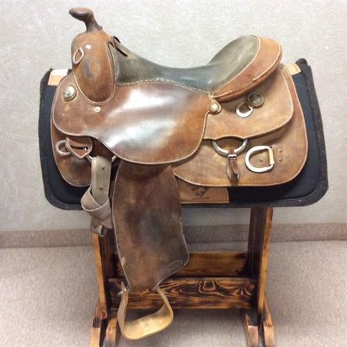 "16"" Steve Flick Training Saddle - Nice quality training saddle! Rough out leather, suede black seat, and training D's. Latigo and off billet."