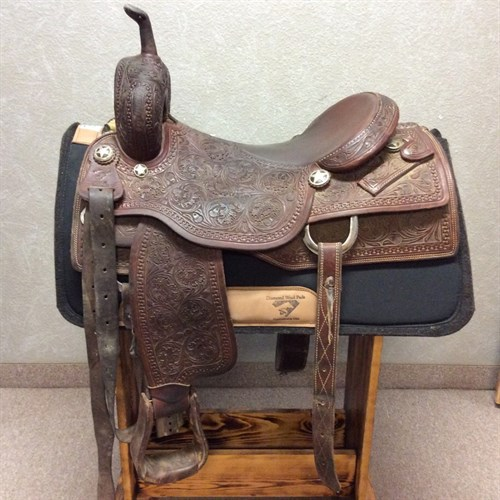 "16 1/2"" Buckstitch Saddle Co. Cutting Saddle - Beautiful Oak leaf with floral tooling, supple leather, great seat with a nice pocket, 9"" front end. Great cutting saddle ready to use."