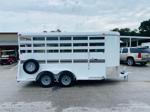 2021 Bee 16' stock bumper pull trailer with an interior height at 7' tall x 6' wide x 16' long, escape door, full swinging center gate, rubber mats over wood floor and a full swinging rear door with half slider! The exterior has two 3500lbs axles with a spare tire, weighs 2800lbs and has a 5 year structural warranty and a Lifetime Warranty on the Floor!