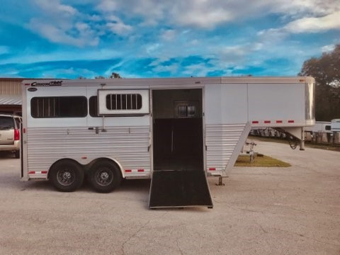 "2007 Cimarron (2+1) GN Trailer with an interior height at 7' 6"" tall x 7'6"" Wide x 16' Long,  6' Front Box Stall, Insulated Roof, Drop Gate Over Neck, Escape Door, Side Ramp with Dutch Door, Air Flow Center Gates, Rubber Mats over All Aluminum Floor and a Rear Ramp with Dutch Doors!   Super Clean Unit."