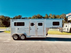 """(REORDERED) 2021 Cimarron (2) horse straight load trailer with a front tack room that has removable saddle racks, bridle hooks, brush box, window in tack room wall and over nose for maximum ventilation. The horse area has an interior height at 7'6"""" tall x 7' wide, two extra wide escape doors, drop down windows with drop down aluminum bars, insulated roof, roof vents, removable divider and head shield, removable chest/butt bars, rubber lined and insulated walls and a rear ramp with dutch doors!"""