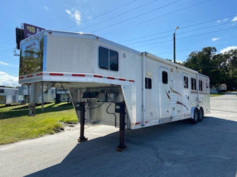 "2007 Lakota (3) horse living quarter with a 14' conversion that has an A/C unit, furnace, couch, 6cu fridge & freezer, cooktop, sink, stereo system, t.v., closets and tons of cabinets! The horse bathroom has a toilet, shower, linen closet, a medicine cabinet and a walk thru door into the horse area. In the horse compartment you have an interior height at 7' 6"" tall x 8' wide, insulated roof,"