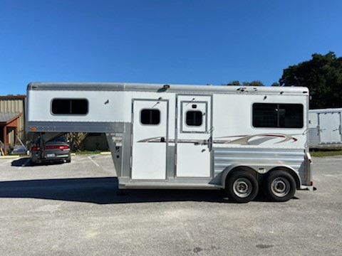 "2007 4star Deluxe (2) horse straight load gooseneck trailer with a front tack room that has saddle racks, bridle hooks and a brush box.  The horse area has an interior height at 7'6"" tall x 7' wide, two escape doors with drop down windows,  removable screens at the drop down windows, removable divider with head shield, rubber lined & insulated walls, rubber mats over all aluminum floor and a rear ramp with dutch doors!   The exterior has a manual jack and a spare tire."