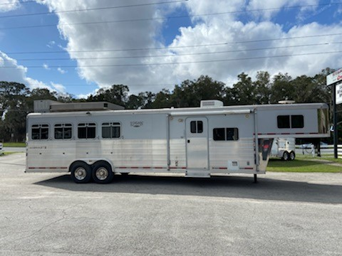 2008 Logan Coach (4) horse living quarter trailer with a 12' Conversion that has a Slide Out with a Coach, A/C unit, double sink, 6 cu fridge & freezer, cabinets, large closets, t.v., large bathroom with a toilet, shower, sink with medicine cabinet, linen closet and a walk thru door.