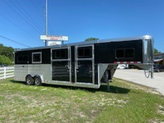 2021 Cimarron (2+1) GN Trailer with a front tack room that has a 5' tack room with a driver side access door, curbside ramp with dutch door.  The horse area has an interior height at 8' tall x 8' wide, escape door, drop down windows, insulated roof, roof vents, air flow center gates, rubber lined & insulated walls, full stud divider, and a rear ramp with dutch doors!   The exterior has a hydraulic jack, aluminum wheels and a spare tire.