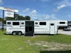 """2021 EBY (4) horse head-to-head with a 4' front tack room that has saddle racks, bridle hooks and a camper door.  The horse area has an interior height at 7'6"""" tall x 6' 10"""" wide, escape door, large sliding bus windows, rubber lined walls, roof vents, electric fans, removable divider,  makes a 4 horse head to head,  or (3) box stalls, side ramp with dutch doors and a rear ramp with dutch doors.  White in color and has a spare tire.  This trailer is basically like new!"""