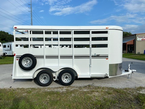 2022 Bee 16' stock bumper pull trailer with an interior height at 7' tall x 6' wide x 16' long, escape door, full swinging center gate, rubber mats over wood floor and a full swinging rear door with half slider! The exterior has two 3500lbs axles with a spare tire, weighs 2800lbs and has a 5 year structural warranty and a Lifetime Warranty on the Floor!