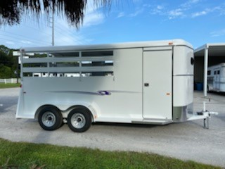 2022 Bee (3) horse slant load bumper pull trailer with a front tack room that has saddle racks, bridle hooks and a solid tack room wall.  The horse area has an interior height at 7' tall x 6' wide, escape door, rubber lined walls, rubber mats over wood floor and a full swinging rear door.  Spare tire.