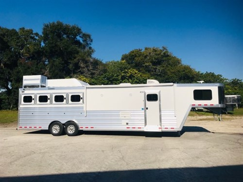"""2020 Cimarron (4) horse slant load living quarter trailer with a 12'9"""" Outback Customs Conversion that has Air Ducted A/C, furnace, dinette/sofa combo, large cabinets, 6cu fridge/freezer, cooktop, convection oven, large closets, area for a T.V. and a huge bathroom. In the bathroom you have a tall toilet, sink with medicine cabinet, radius shower, linen closet and a walk thru door into the horse area."""